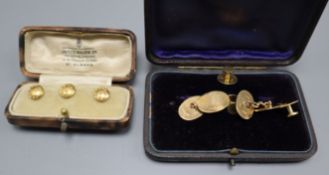 A cased set of three 18ct. dress studs, one other set of three and a pair of 9ct. gold cufflinks.
