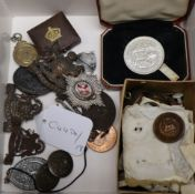 A collection of military buttons, badges, coins etc