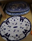 Two blue and white meat platters, a similar platter and a willow-patterned platter
