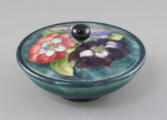 A Moorcroft 'clematis' powder bowl and cover, 1930/40's, impressed mark W. Moorcroft Potter to HM