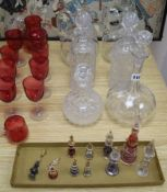 A collection of cranberry and decanters, etc.