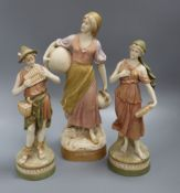 A Royal Dux figure of a girl carrying pitchers and pair of ditto (one a.f.) tallest 38cm
