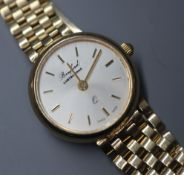 A lady's 9ct gold quartz wrist watch, retailed by Bruford's, on a 9ct gold bracelet.