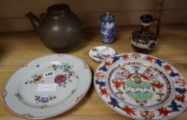 A Chinese export 'Somers' armorial plate, Kangxi period, c.1715, blue and white vase and mixed