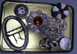 A Scottish silver and citrine brooch, two pill boxes, hardstone brooch, two belts and a knot