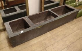 A heavy terracotta horse trough 182 x 46cm