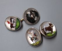 A pair of 14k and white metal Essex crystal cufflinks, depicting horse and rider and a dog.