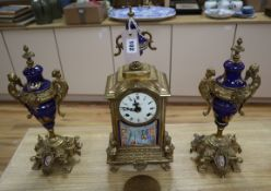 A gilt metal and porcelain mounted three piece clock garniture