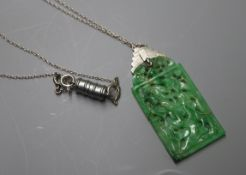 A 1930's white metal mounted pierced jade pendant, on chain, pendant 46mm.
