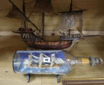 A ship in a bottle and a model galleon