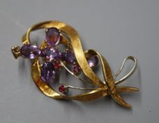 An 18ct white and yellow gold openwork ruby-set ribbon brooch and a 9ct gold and amethyst cross