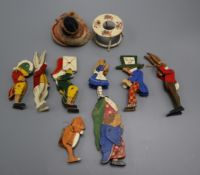 A group of miniature dolls and wooden toys