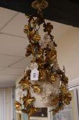 A gilt metal floral light fitting