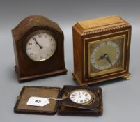 A Victorian travelling timepiece, an Elliot mantel timepiece and one other