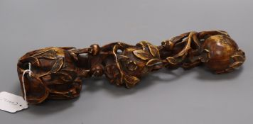 A Chinese carved wood pomegranate ruyi sceptre length 35cm