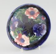 A Moorcroft 'anemone' cobalt blue ground bowl, c.1950, impressed mark Moorcroft Made in England,