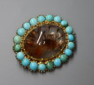 A late Victorian yellow metal, rutilated quartz and turquoise set oval brooch, 24mm.