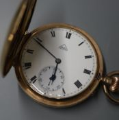 A 9ct gold keyless hunter pocket watch with white enamelled Roman dial signed Dent.