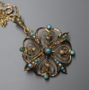 An early 20th century 9ct, turquoise and seed pearl set openwork pendant, on a yellow metal fine
