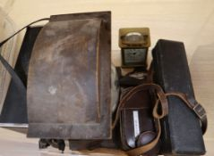 A brass carriage timepiece, a cased compass and goliath watch, two cine cameras, a clock, etc.