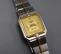 A lady's steel and gold plated Longines quartz wrist watch.