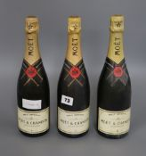 Three bottles of Moet & Chandon champagne