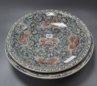 Two Chinese pottery saucer-shaped dishes