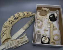 A group of Chinese and Indian export ivory carvings, all pre-1940 and a carved boar's tusk