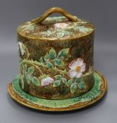 A George Jones majolica 'wild rose' pattern cheese dome on stand height 26cm