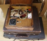 A collection of 1920's- 1950's medical equipment including boxed electro shock machines etc