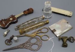 A glass seal, scissors, perfume bottles and mixed collectibles