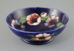 A Moorcroft 'anemone' footed bowl, 1930/40's, with a cobalt blue ground, impressed mark W. Moorcroft