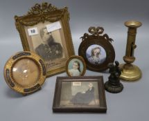 A framed portrait enamel miniature, four others, a candlestick and metal statue