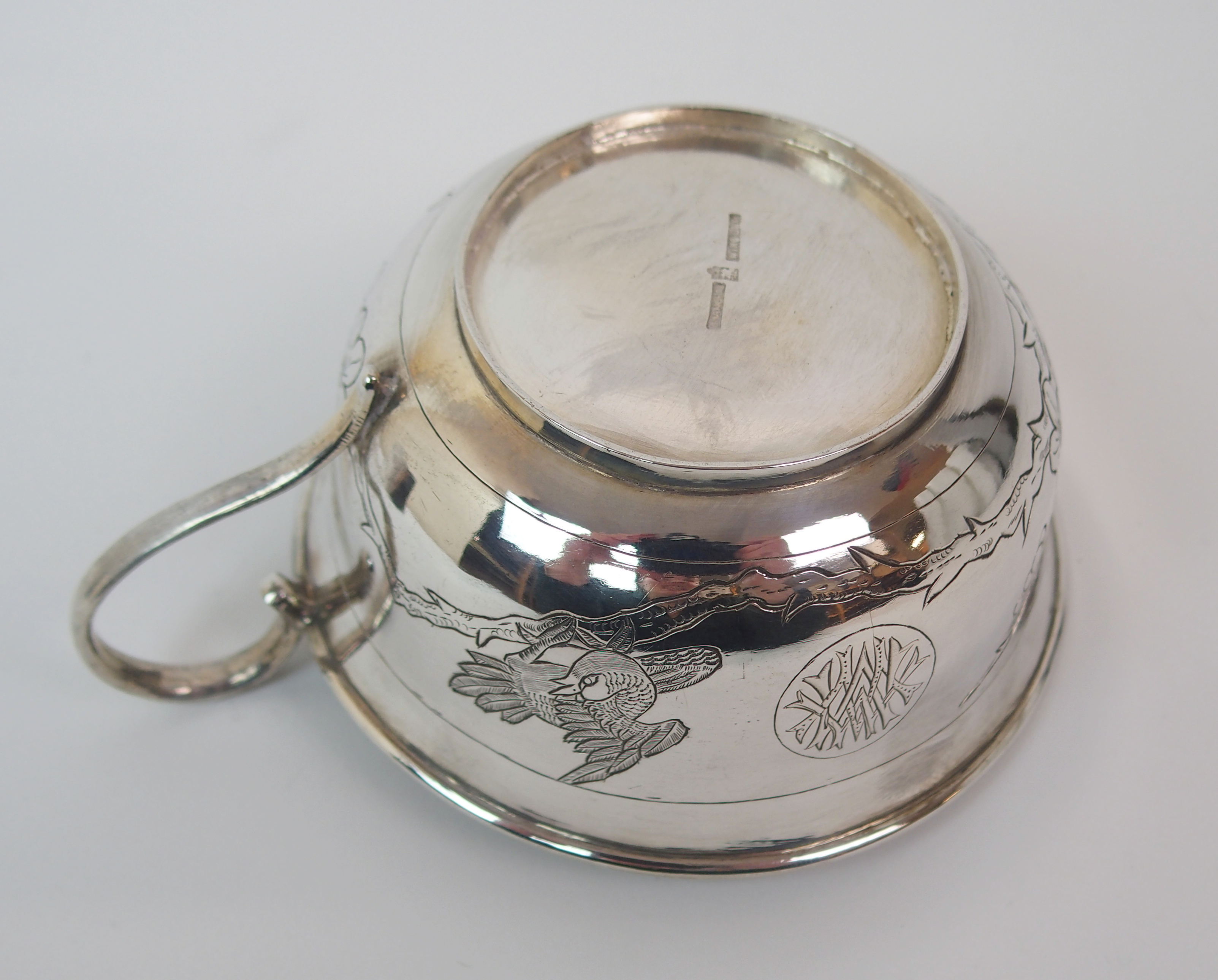 Lot 2 - A CHINESE SILVER TANKARD engraved with a bird amongst blossom beside a circular monogrammed