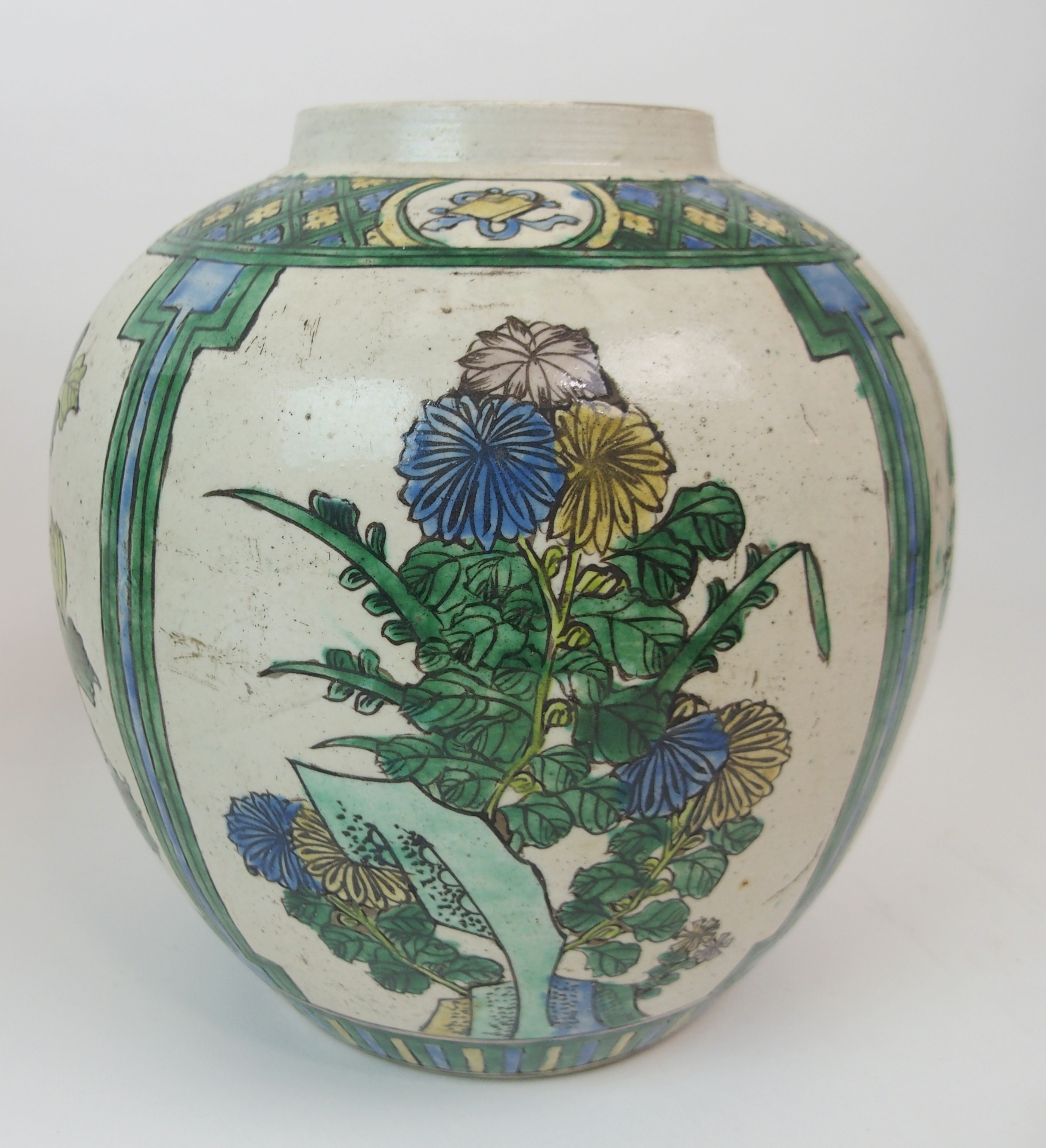 Lot 15 - A SUMIDA WARE BALUSTER VASE AND DOMED COVER applied in high relief with Kannon, devotee and precious