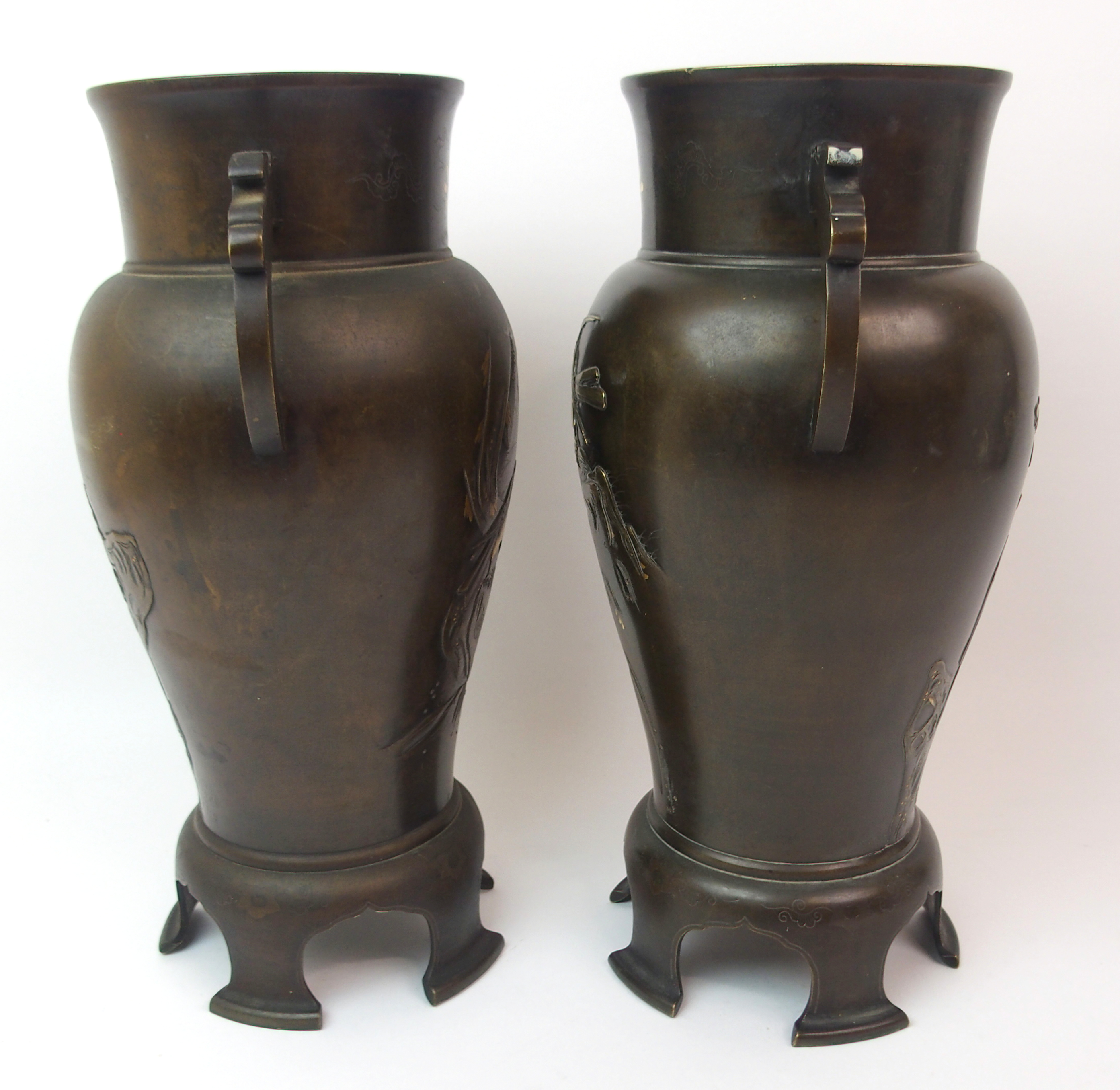 Lot 31 - A PAIR OF JAPANESE BRONZE TWO-HANDLED BALUSTER VASES decorated with peonies issuing from rockwork
