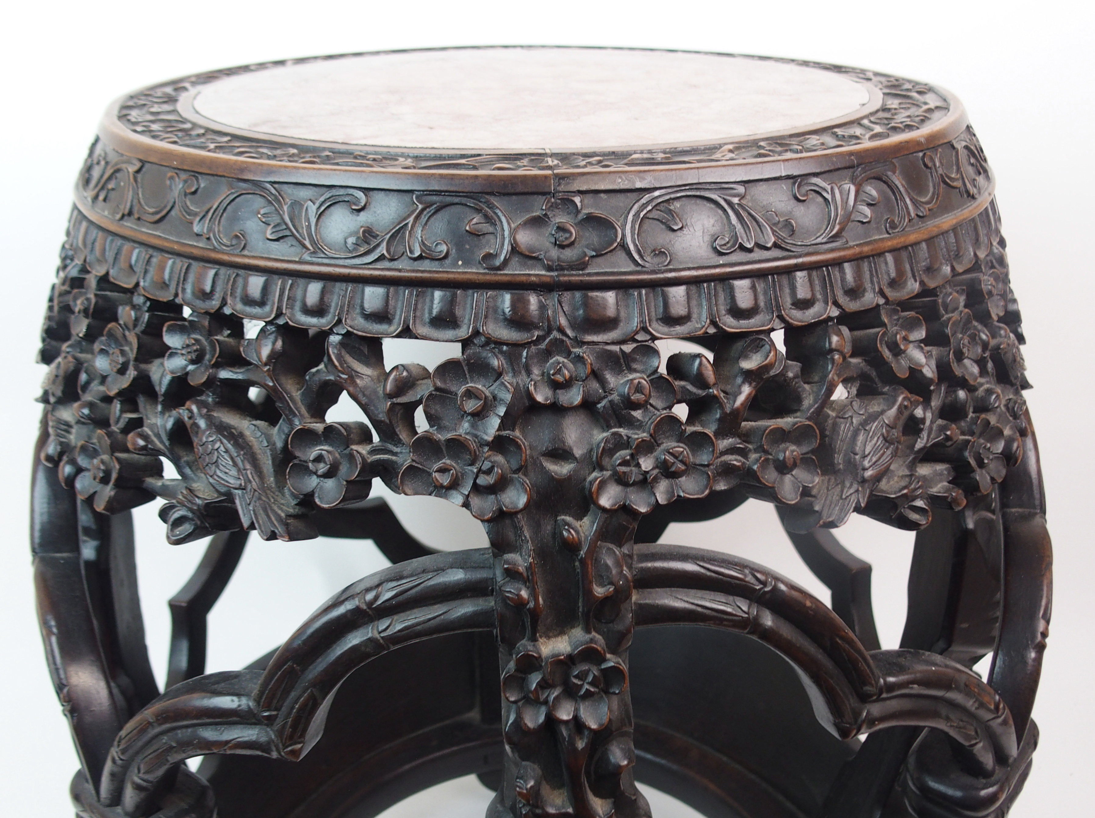 Lot 52 - A CHINESE ROSEWOOD BARREL SHAPED CONSERVATORY SEAT the marble inset top within carved floral spray