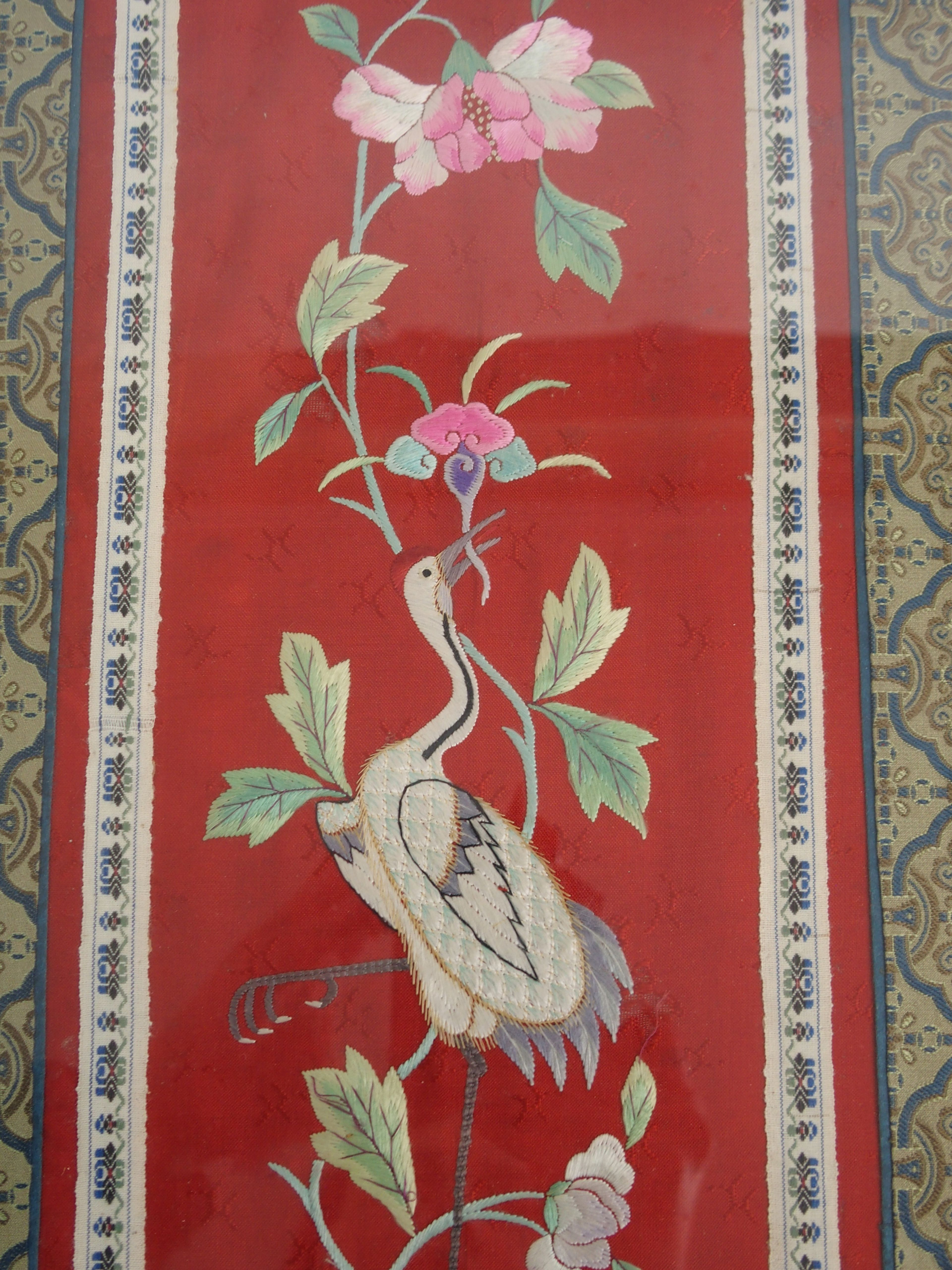 Lot 20 - A CHINESE SILK EMBROIDERED PANEL the circular medallion woven with four dragons within borders of