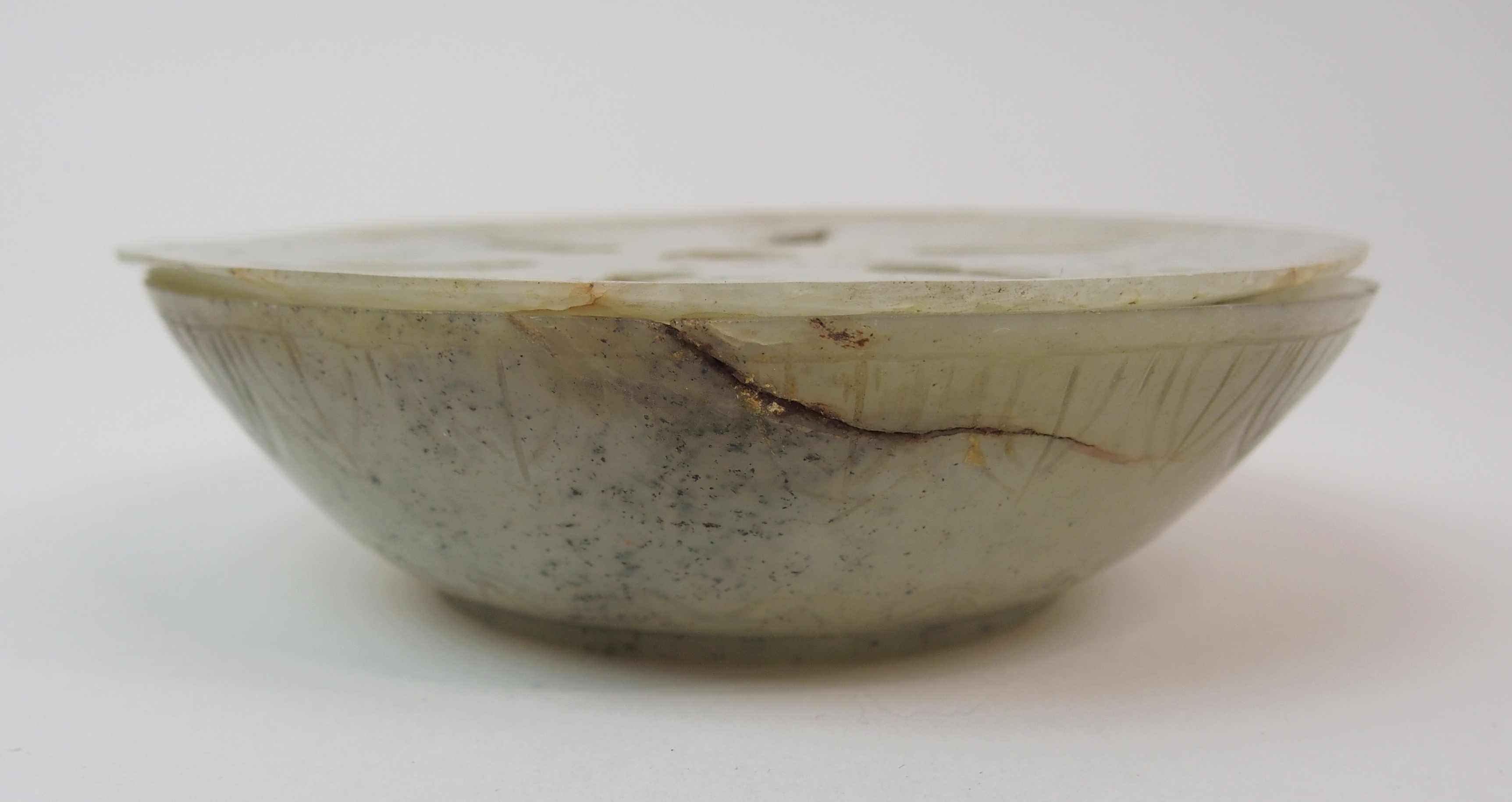Lot 37 - AN INDIAN JADE CARVED CENSER the shallow bowl with stiff leaf banding (hairline cracks) and