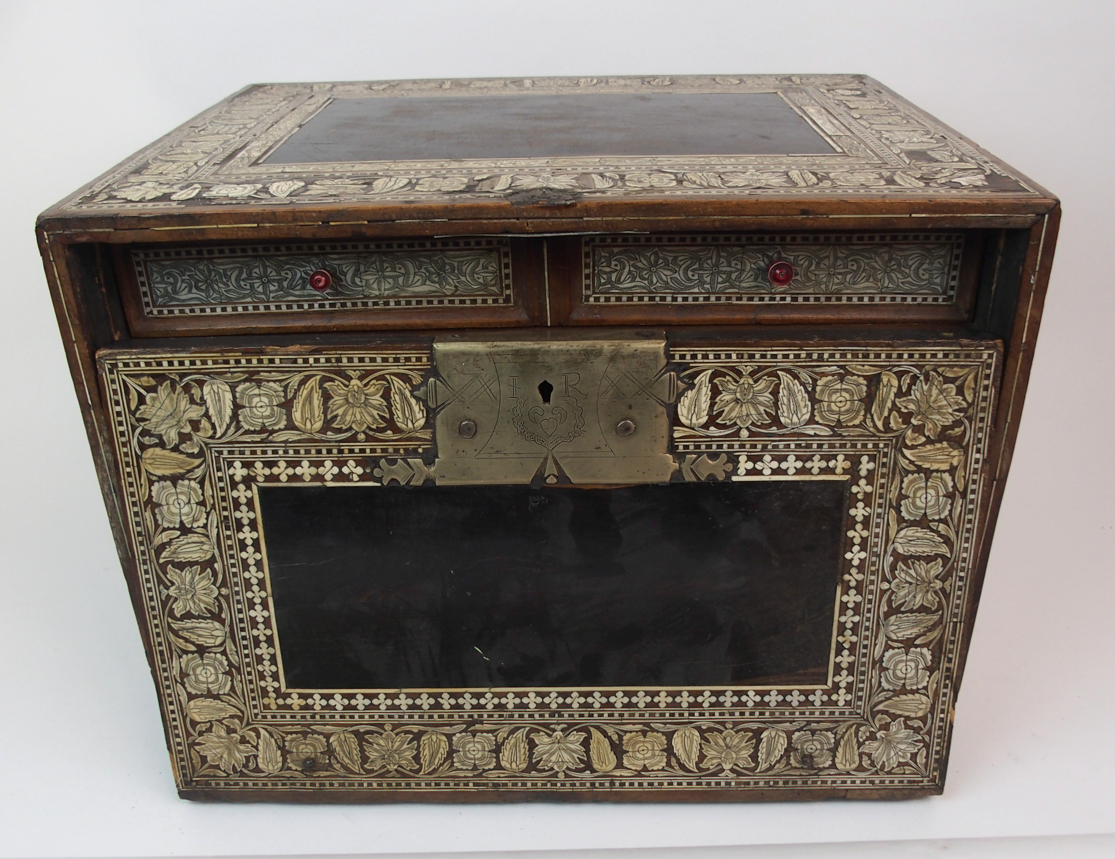 Lot 46 - A MUGHAL (INDO-PORTUGUESE) HARDWOOD AND IVORY INLAID COLLECTORS CABINET decorated with bands of