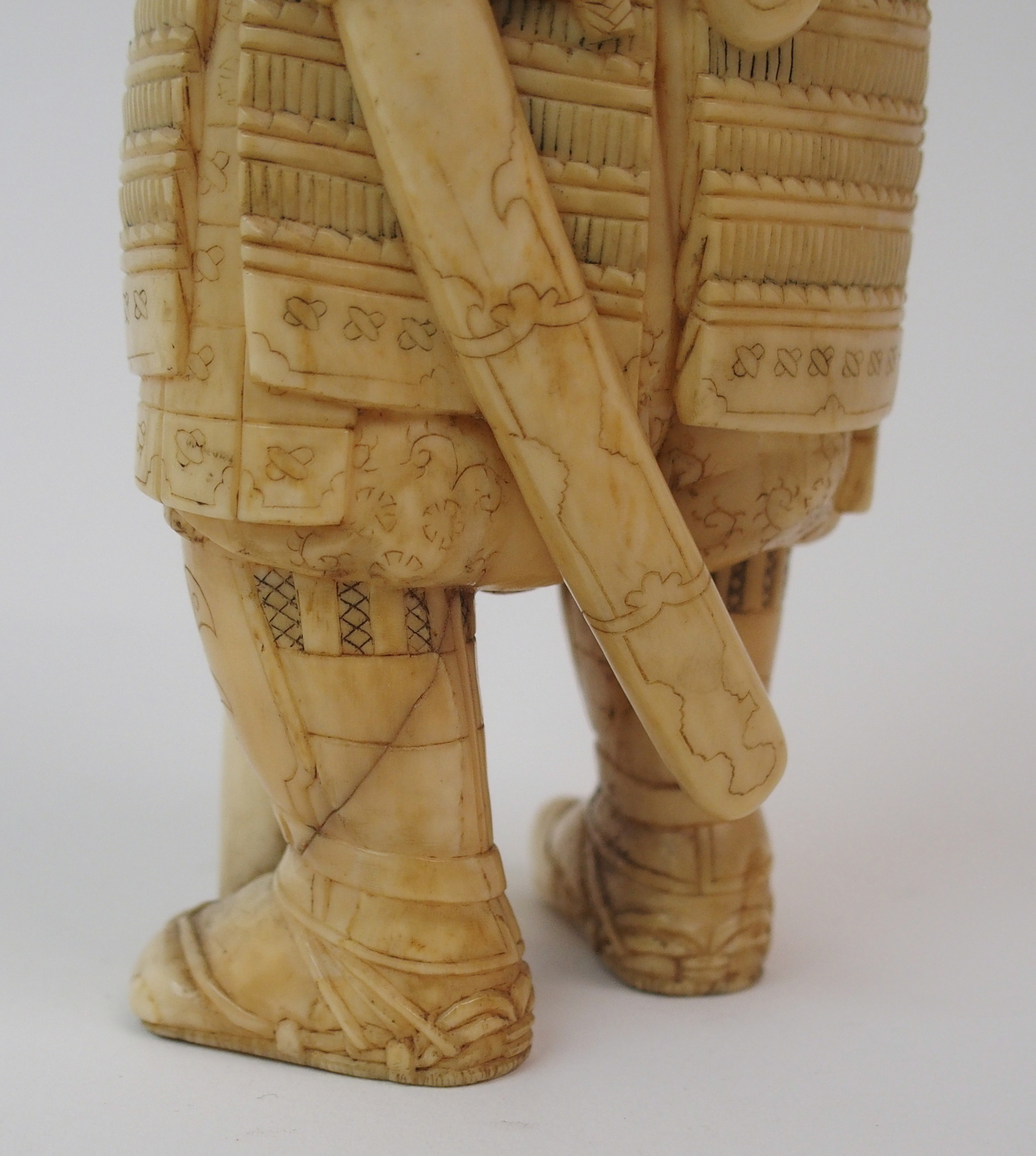 Lot 23 - AN IVORY OKIMONO OF A DISHEVELLED FISHERMAN on a wood stand, 22cm high, an Okimono of a flautist,
