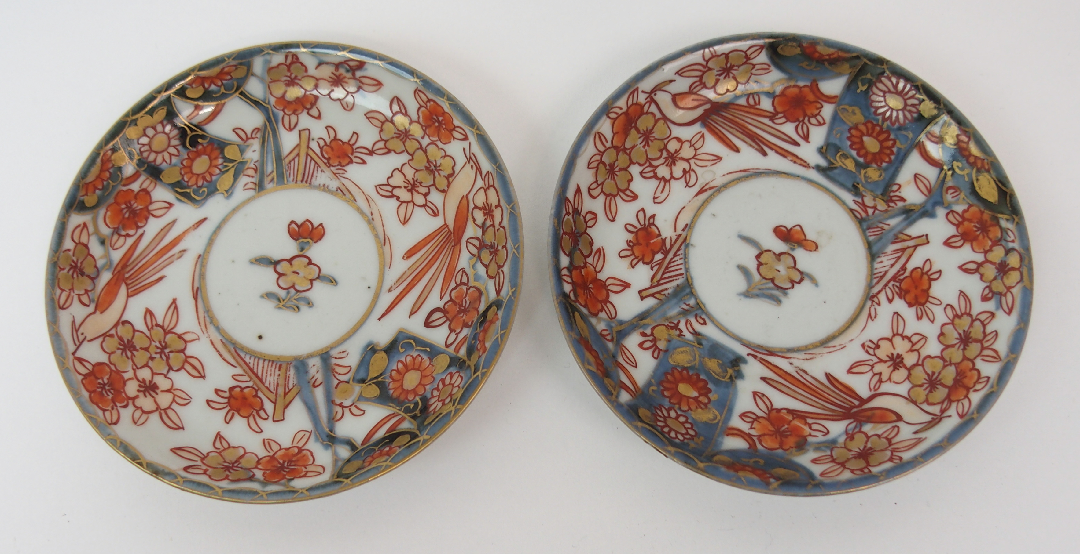 Lot 3 - A CHINESE FAMILLE ROSE CHARGER painted with cockerels amongst foliage and blue rockwork within a