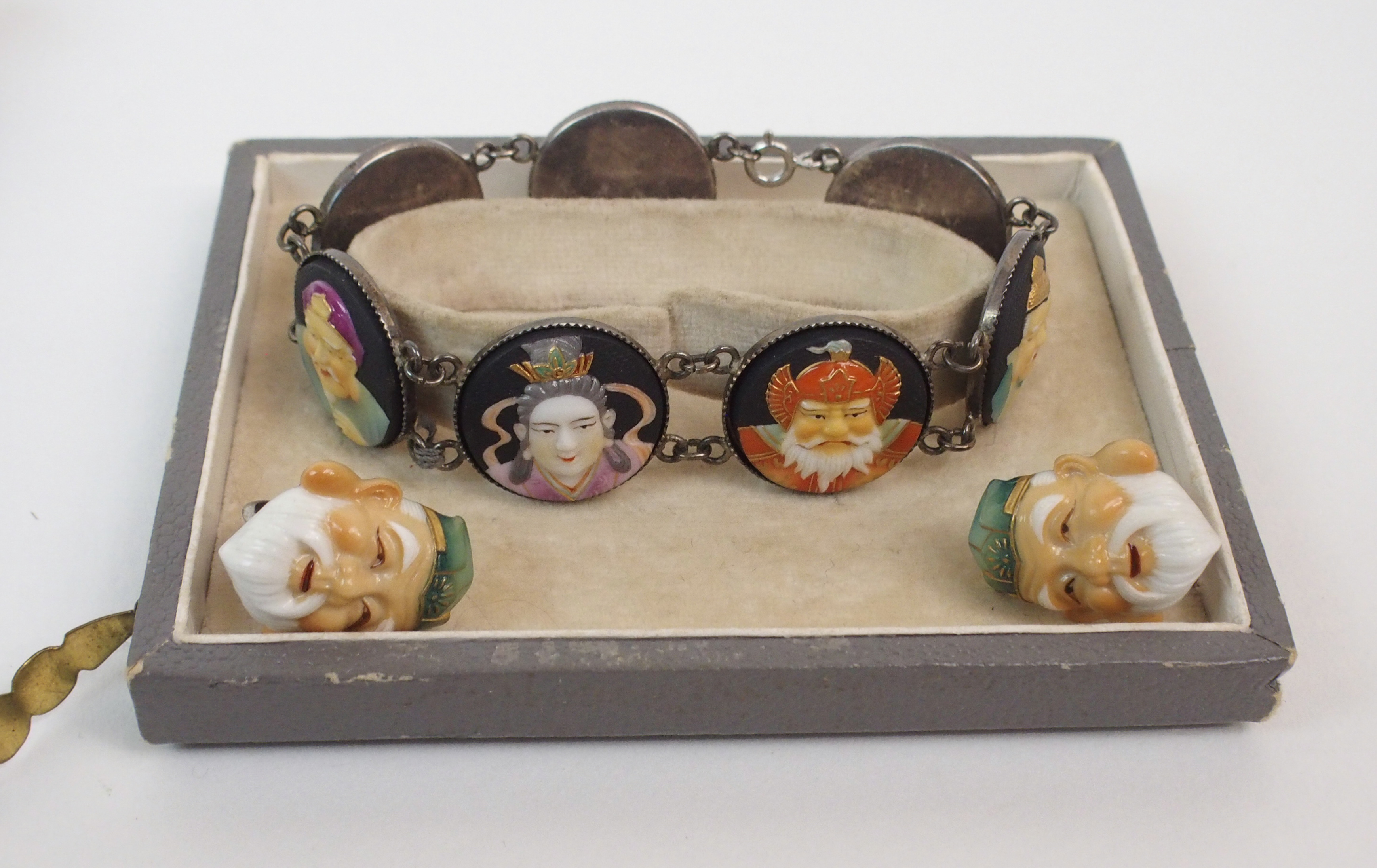 Lot 59 - A TOSHIKANE BRACELET AND EARRINGS with seven Gods of Luck in ceramic medallions on white metal
