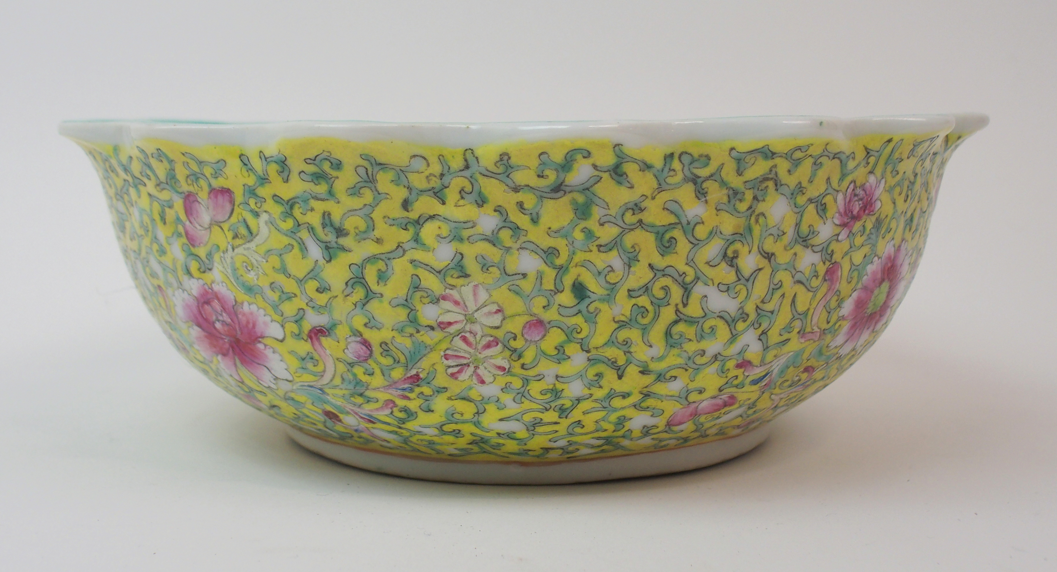 Lot 6 - A CHINESE YELLOW GROUND FRILLED BOWL exterior with peonies and scrolling foliage, Qianlong seal mark