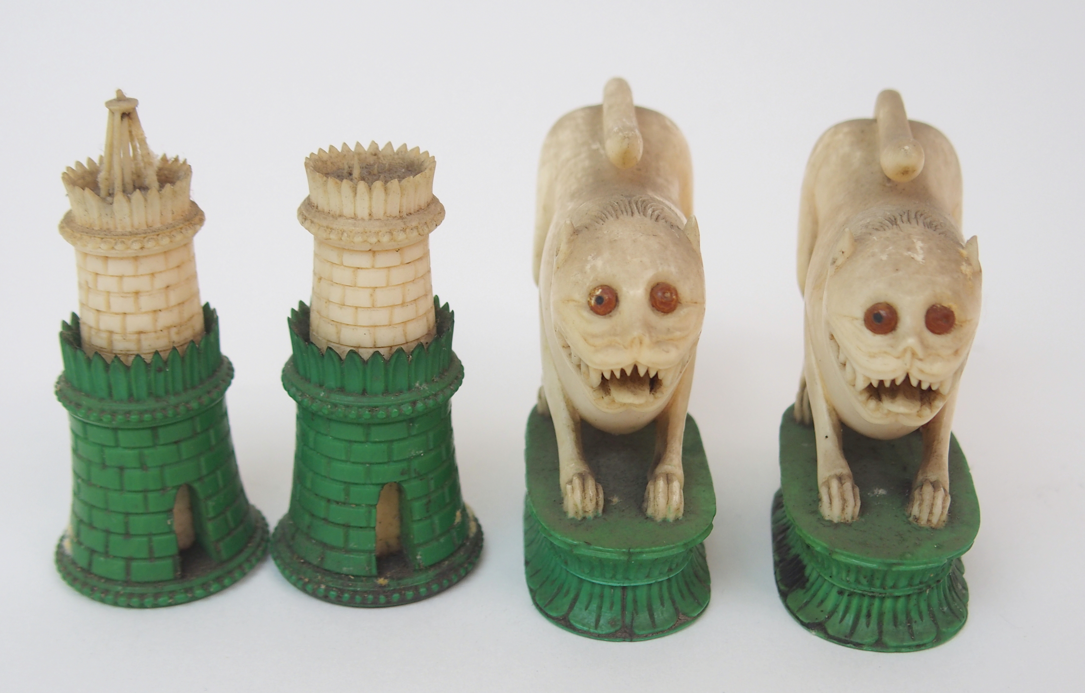 Lot 40 - AN EAST INDIAN IVORY CHESS SET probably Berhampore, one set with black stained bases lacking two