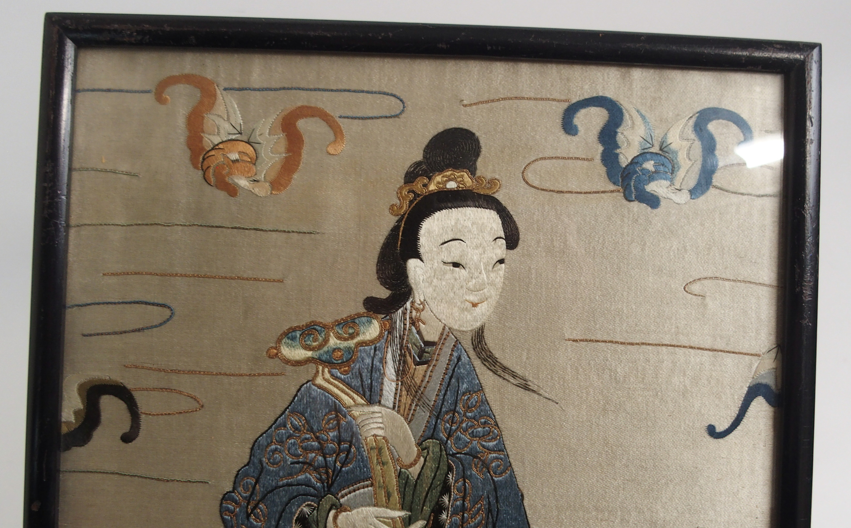 Lot 26 - A PAIR OF CHINESE SILK EMBROIDERED PANELS each with a lady with a kylin or monkey surrounded by