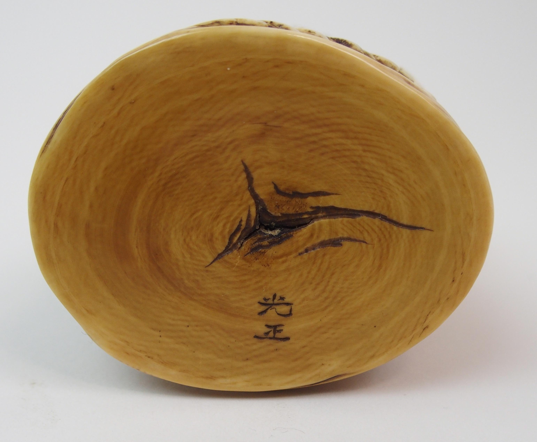 Lot 25 - AN IVORY OKIMONO OF A DRAGON KING GROUP surrounding a dragon amongst crashing waves, signed, 6cm