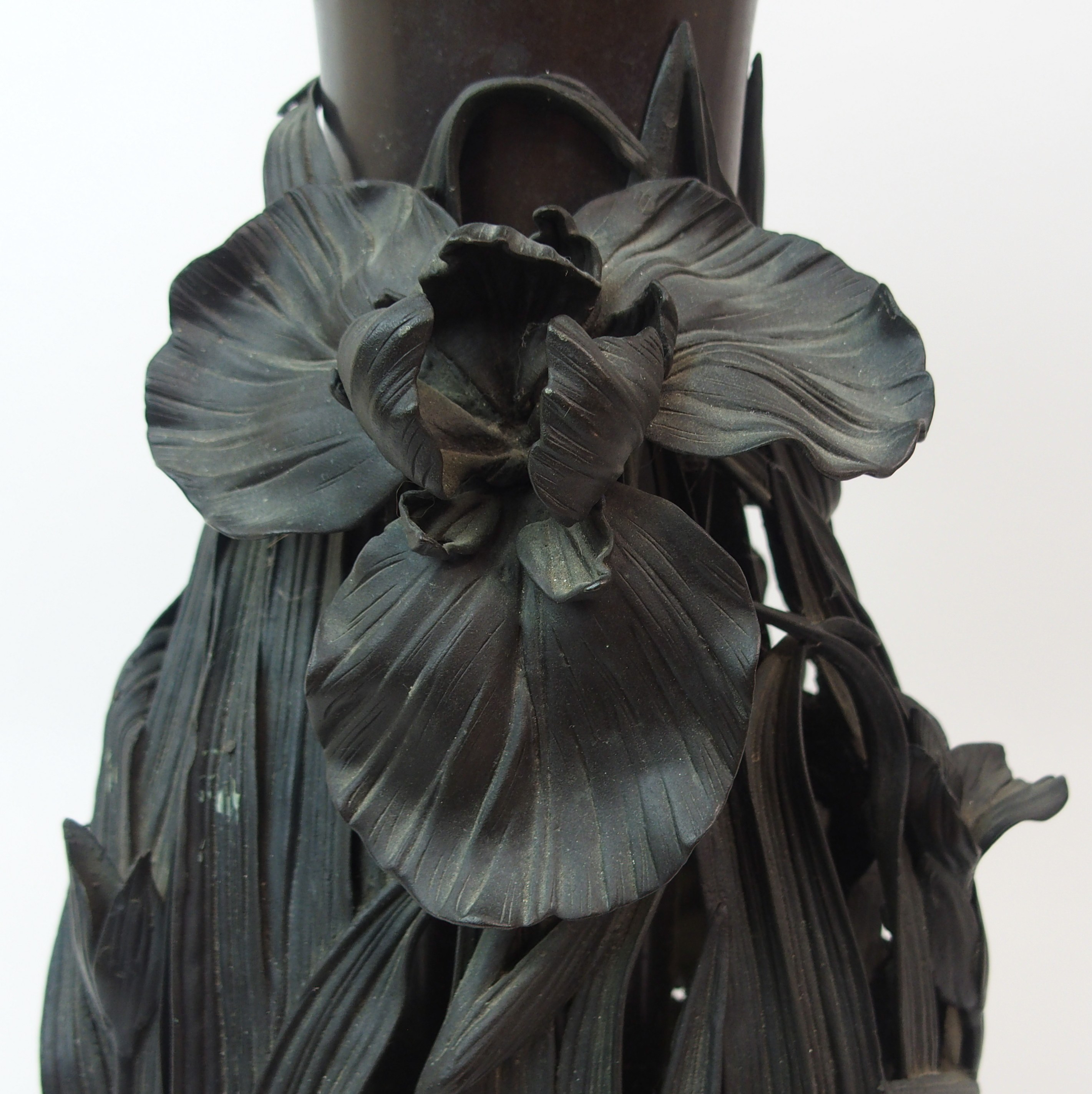 Lot 13 - A JAPANESE BRONZE VASE pierced and cast in high relief with irises and aquatic foliage, signed to