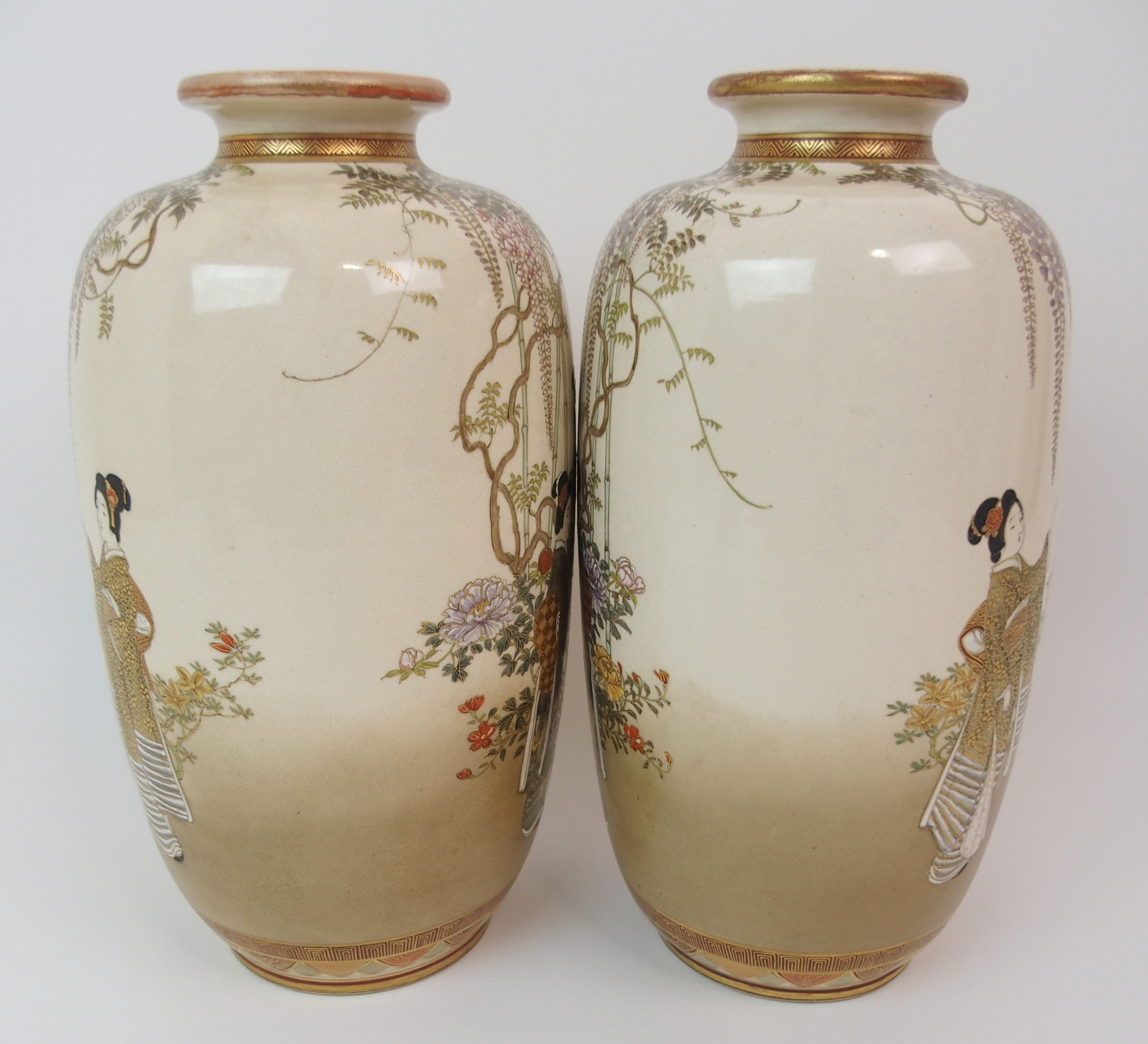 Lot 35 - A PAIR OF SATSUMA VASES painted with ladies and children beneath wisteria and amongst flowers,