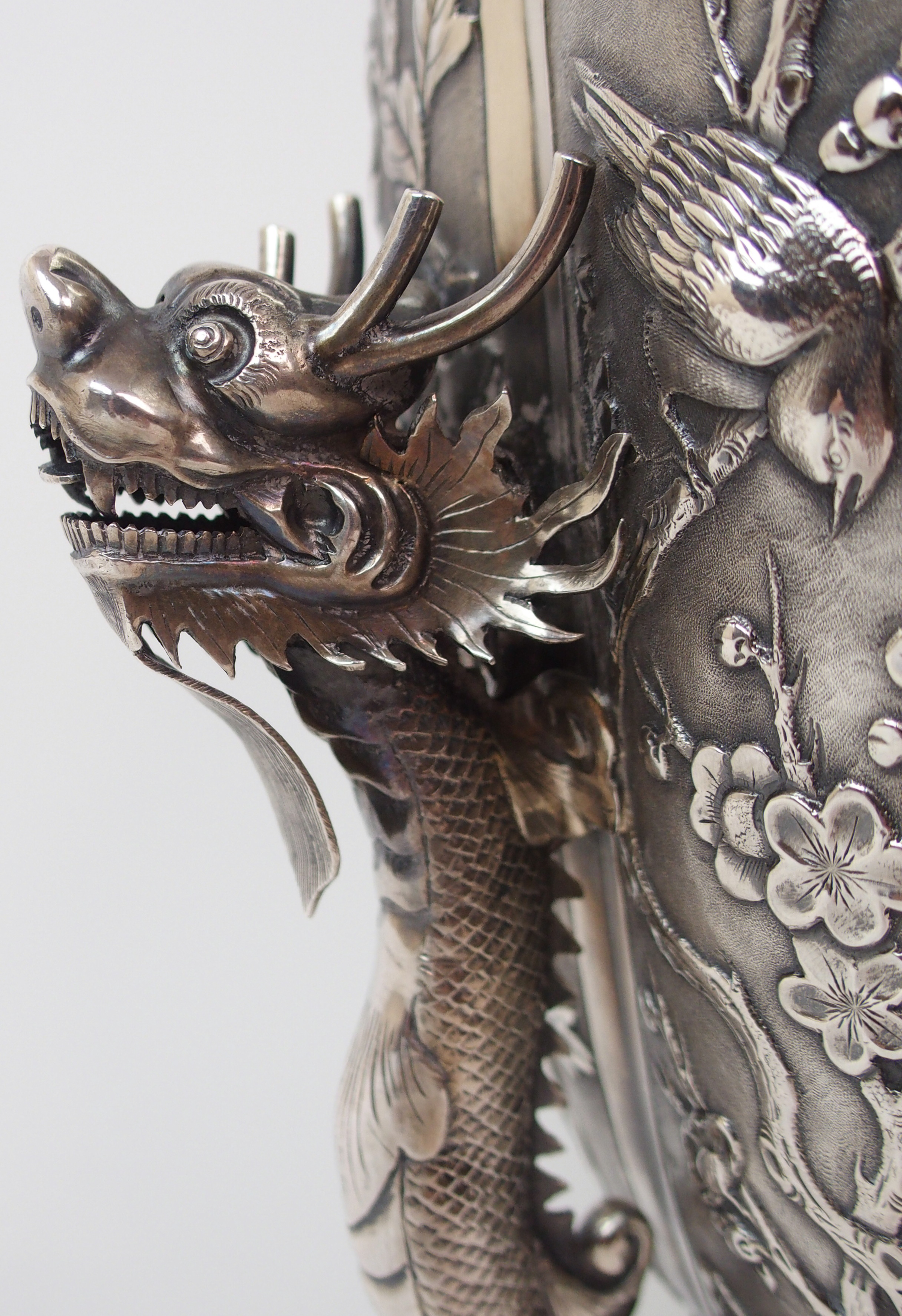 Lot 1 - A CHINESE SILVER PRESENTATION LOBED VASE decorated with panels of figures, dragons, birds and